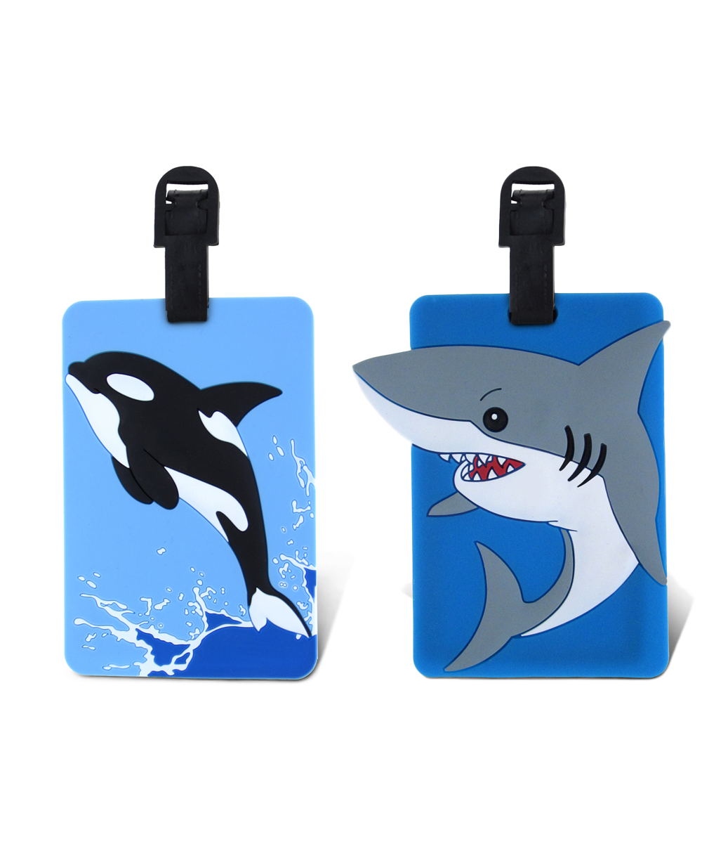 Black Whale & Gray Shark Luggage Tags Black Whale & Gray Shark Luggage Tags. Make it easy for little ones to spot their luggage at baggage claim with these fun tags. Includes two tags9'' W x 13'' HPVCImported