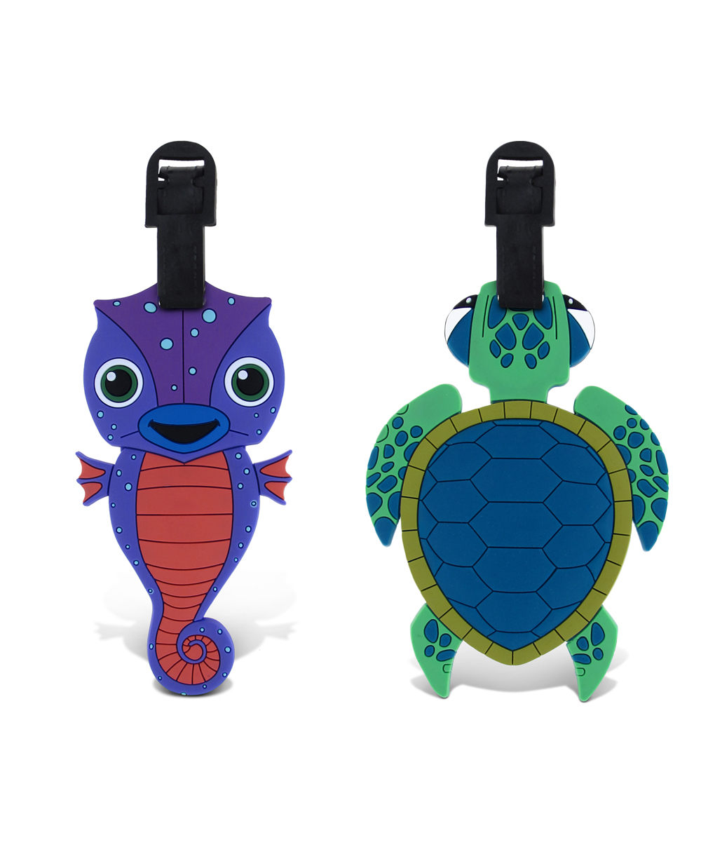 Puzzled  Luggage Tags  - Blue Seahorse & Green Sea Turtle Luggage Tags Blue Seahorse & Green Sea Turtle Luggage Tags. Make it easy for little ones to spot their luggage at baggage claim with these fun tags. Includes two tags9'' W x 13'' HPVCImported