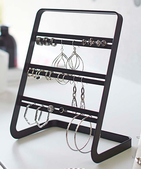 Black Earring Stand Black Earring Stand. Hang your earrings on this stand for simplified storage of dazzling accessories. 6'' W x 7.8'' H x 4.1'' DSteelImported