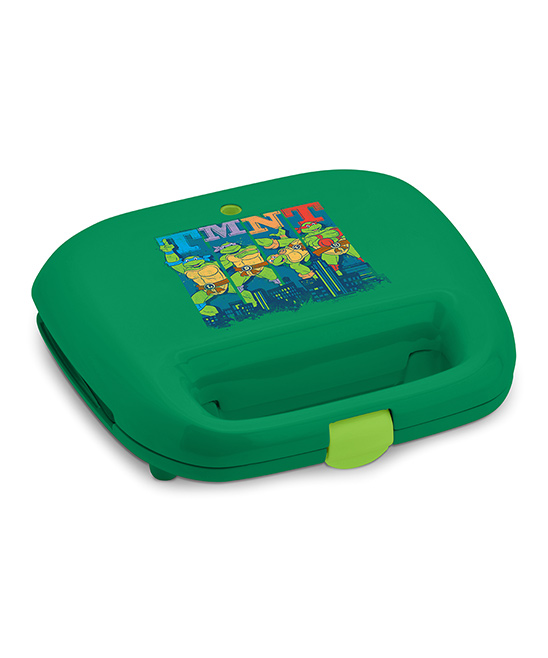 Select Brands  Waffle Makers  - TMNT Two-Slice Waffle Maker TMNT Two-Slice Waffle Maker. Make your own waffles to share with hungry Teenage Mutant Ninja Turtle fans using this appliance outfitted with the turtle-rrific heroes. 10.6'' W x 5'' H x 14.2'' DPlastic / cast aluminum / rubber760 WNonstickHand washImported