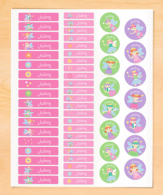 Olive Kids  Labels  - Fairies Personalized Iron-On Clothing Labels Fairies Personalized Iron-On Clothing Labels. Your youngster can embellish their clothes in playfully personalized style with these delightful labels featuring their own name. These iron-on accents stick to your clothes through repeated washing and drying. Full graphic text: (personalized name)Includes 56 labelsSmall rectangle: 1.75'' W x 0.38'' HLarge rectangle: 2.38'' W x 0.5'' HSheet: 8.5'' W x 11'' HWoven polyesterShipping note: This item will be personalized just for you. Allow extra time for your special find to ship.