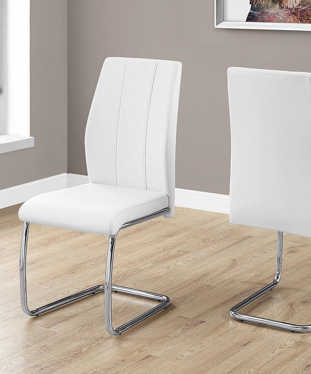 Monarch Specialties  Dining Chairs White - White Minimalist Side Chairs White Minimalist Side Chairs. Featuring contoured seats, these modern side chairs impress with sleek lines and minimalist frames for plenty of contemporary flair. Generously cushioned seats support with comfort. Includes two side chairsWeight capacity: 200 lbs.17'' W x 38'' H x 20'' DSeat height: 18'' HPolyurethane / foam / metalAssembly requiredImported