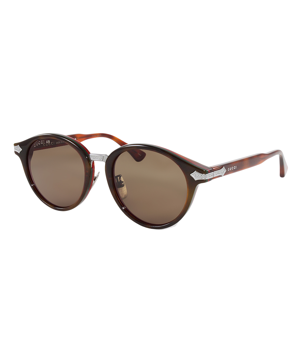 Brown Tortoise Modified Round Sunglasses - Men Brown Tortoise Modified Round Sunglasses - Men. Modern meets retro in this eye-shading designer pair, boasting a classic tortoise texture and elegantly embossed silver accents.Includes sunglasses, cleaning cloth and caseLens width: 50 mmBridge distance: 20 mmArm length: 145 mmPlastic100% UV protectionMade in Italy