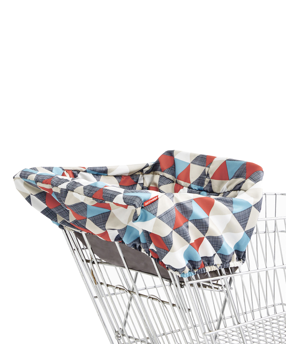 Skip Hop  Shopping Cart and High Chair Covers TAKE - Red & Blue Triangles Shopping Cart Cover Red & Blue Triangles Shopping Cart Cover. Bring extra comfort to out-and-about activities with this soft shopping cart cover that slips on easily to most shopping carts or high chairs. The snap open loop enables it to hang from a stroller for convenient storage. Fits most shopping carts and restaurant-style high chairs12'' W x 7'' H x 20'' DCollapsibleSnap-open loop for convenient carryingExtra-soft fabricBPA-free / PVC-free / phthalate-freeMachine washImported