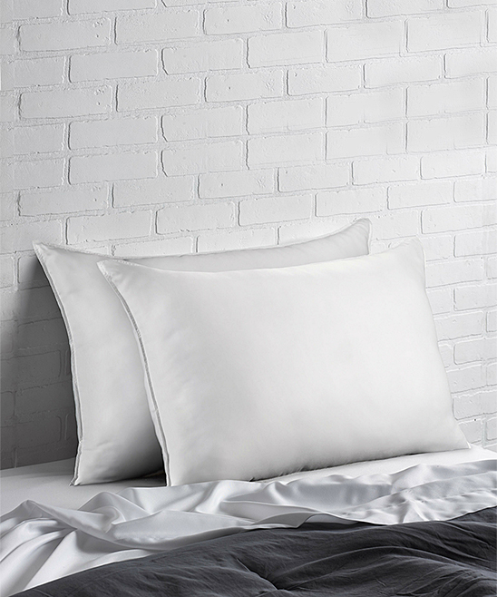 Superior Down-Like SOFT Pillows - Set of Two Superior Down-Like SOFT Pillows - Set of Two. The soft, fluffy feel of these comfy pillows ensures you can't wait to go to bed every night.Includes two pillows50% polyester / 50% cottonHypoallergenicMachine washImported
