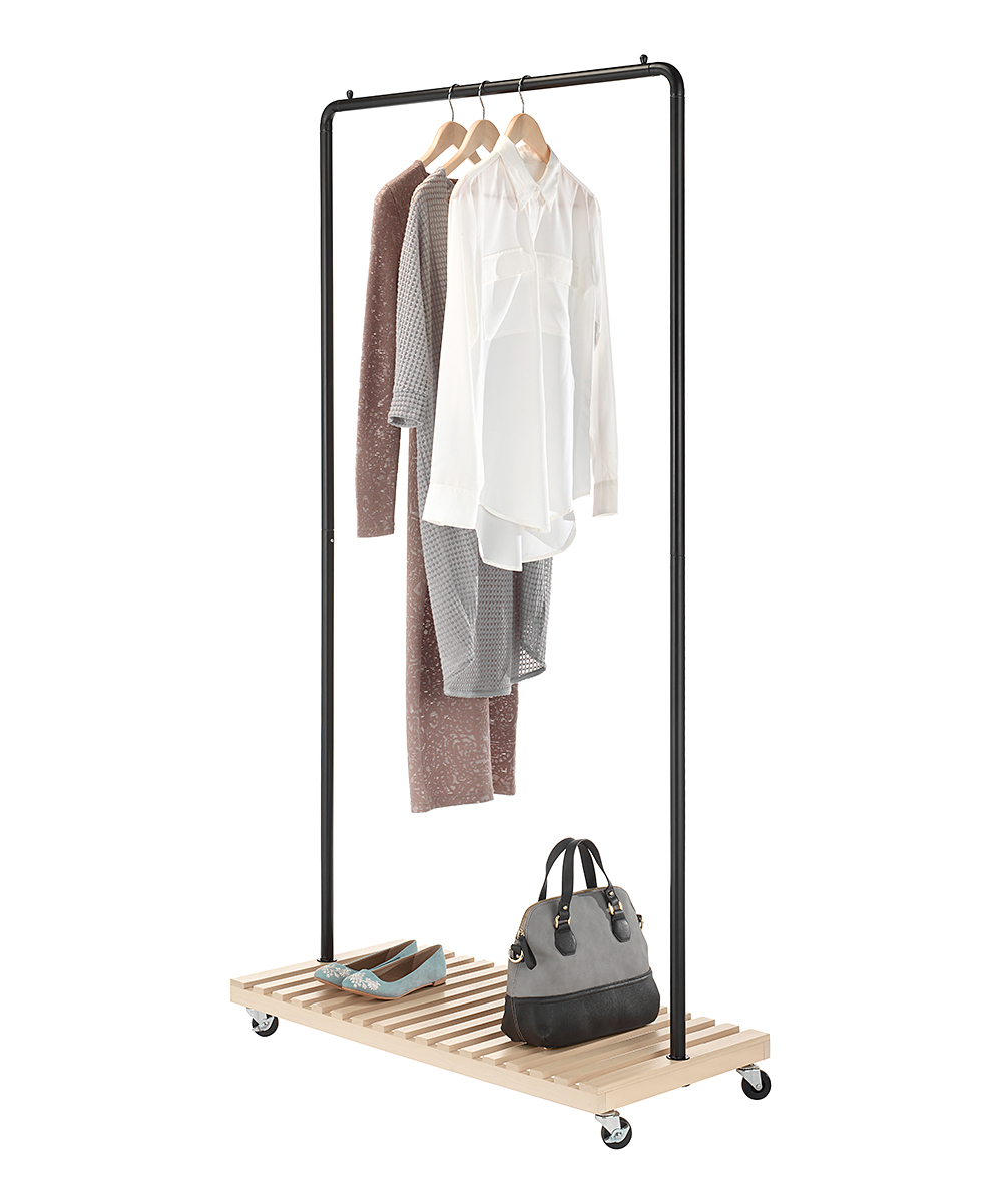 Slat Wood Garment Rack Slat Wood Garment Rack. Keep your space free of clutter with this mobile hanging rack that stores overflow clothing and accessories and conveniently wheels from one space to another.36.25'' W x 69.25'' H x 17.13'' LWood / metal / plasticImported