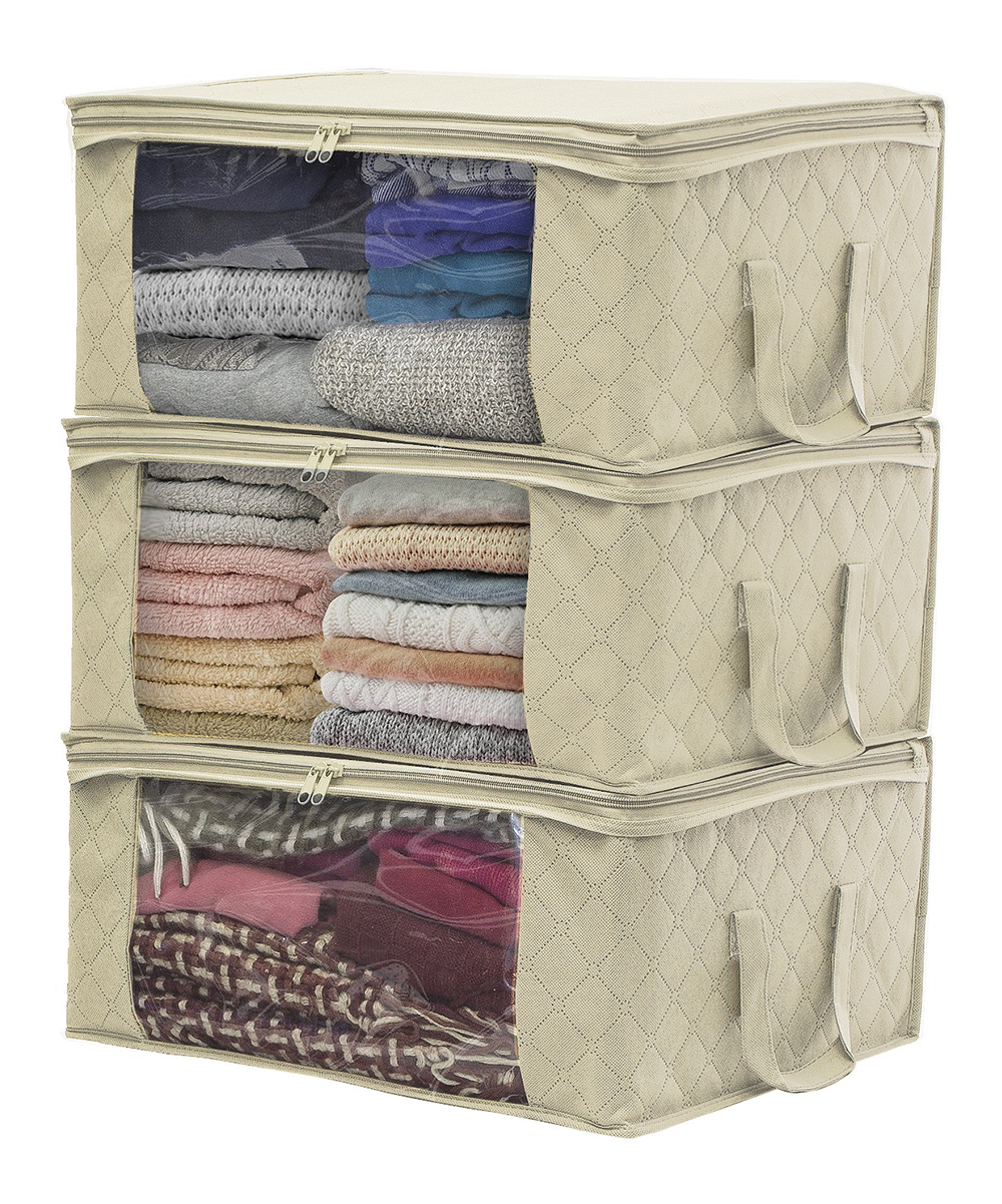 Beige Clothing Storage Bag - Set of Three Beige Clothing Storage Bag - Set of Three. Organize your clothes, towels and extra blankets with these storage bags that conveniently slide under the bed to save space. The sturdy handles allow for effortless transport. Includes three storage bags24'' W x 12'' H x 13'' DPolypropyleneImported