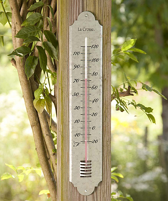 Galvanized Thermometer Galvanized Thermometer. Featuring a keyhole for convenient hanging indoors or outdoors, this thermometer keeps you updated on the temperature and boasts galvanized metal for a farmhouse feel. 3.5'' W x 19.5'' H x 0.25'' DScale from -20 to 110Mercury-freeMetalImported