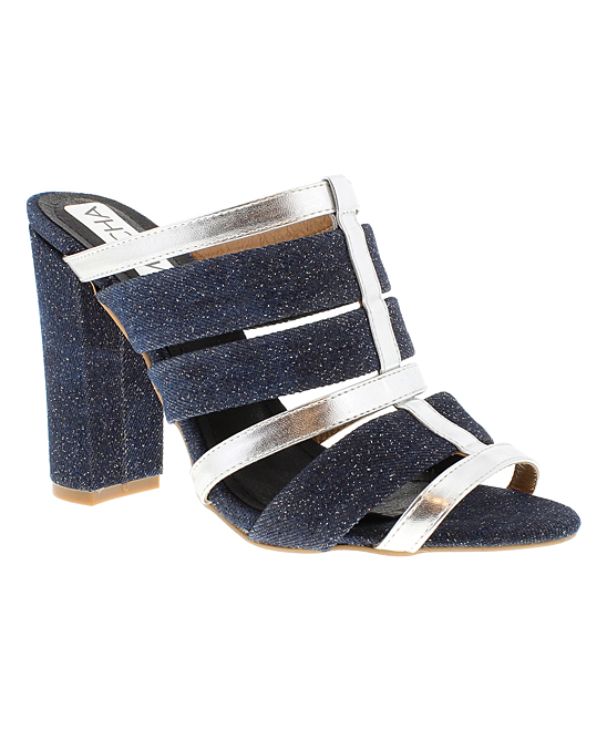 Blue Denim Strappy Tisha Sandals - Women Blue Denim Strappy Tisha Sandals - Women. From distressed denim to a little black dress, this pair of sandals will provide effortless chic style with an elevated heel and revealed toes.3.5'' heelPull-onMan-madeImported