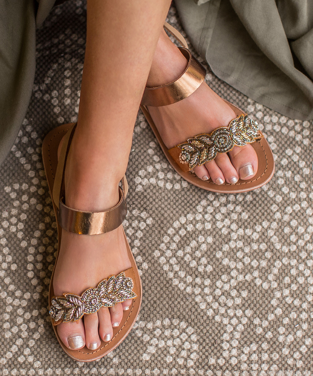 Bronze Nikita Leather Sandals - Women Bronze Nikita Leather Sandals - Women. A luxe leather design means long-lasting style for these chic sandals that elevate your ensemble. Buckle closureLeather upperMan-made liningMan-made soleImported