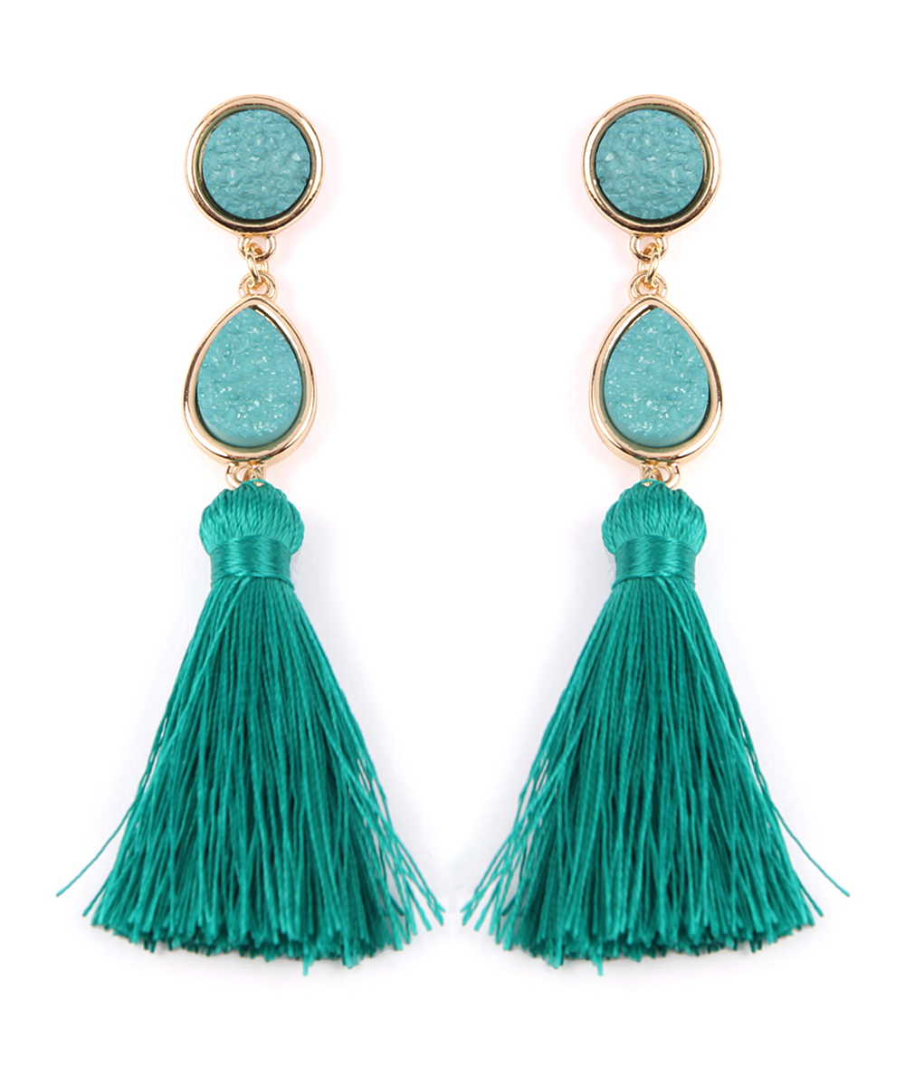 Teal & Goldtone Druzy Tassel Drop Earrings Teal & Goldtone Druzy Tassel Drop Earrings. Add textured movement to your accessory collection with these tassel drop earrings that feature a goldtone plating for modern appeal.  3.5'' HGoldtone base metal / polyester Imported