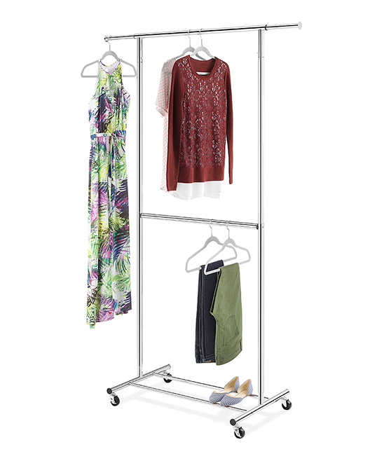 White Extendable Two-Rod Garment Rack White Extendable Two-Rod Garment Rack. Boasting a decor-complementing design and durable extendable design, this garment rack keeps clothing neatly tucked away and wrinkle-free.20.5'' W x 78.875'' H x 32.375'' DPlastic / metalImported