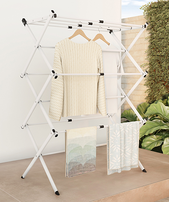 Expandable Three-Tier Clothes Drying Rack Expandable Three-Tier Clothes Drying Rack. Dry clothes with easy by using this innovatively designed clothing rack that folds down for easy storage.  39.25'' W x 17'' H x 15'' DPowder-coated steel / plastic 5.35 lbs.Imported