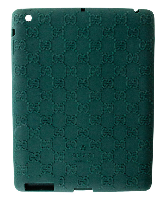 Green Gucci Log Ipad Case Green Gucci Log Ipad Case. Lend your tablet a little glamour when you encase it in this durable plastic case embellished with the signature Gucci logo. 9.4'' W x 7.32'' H x 0.31'' D100% silicone plasticMade in Italy