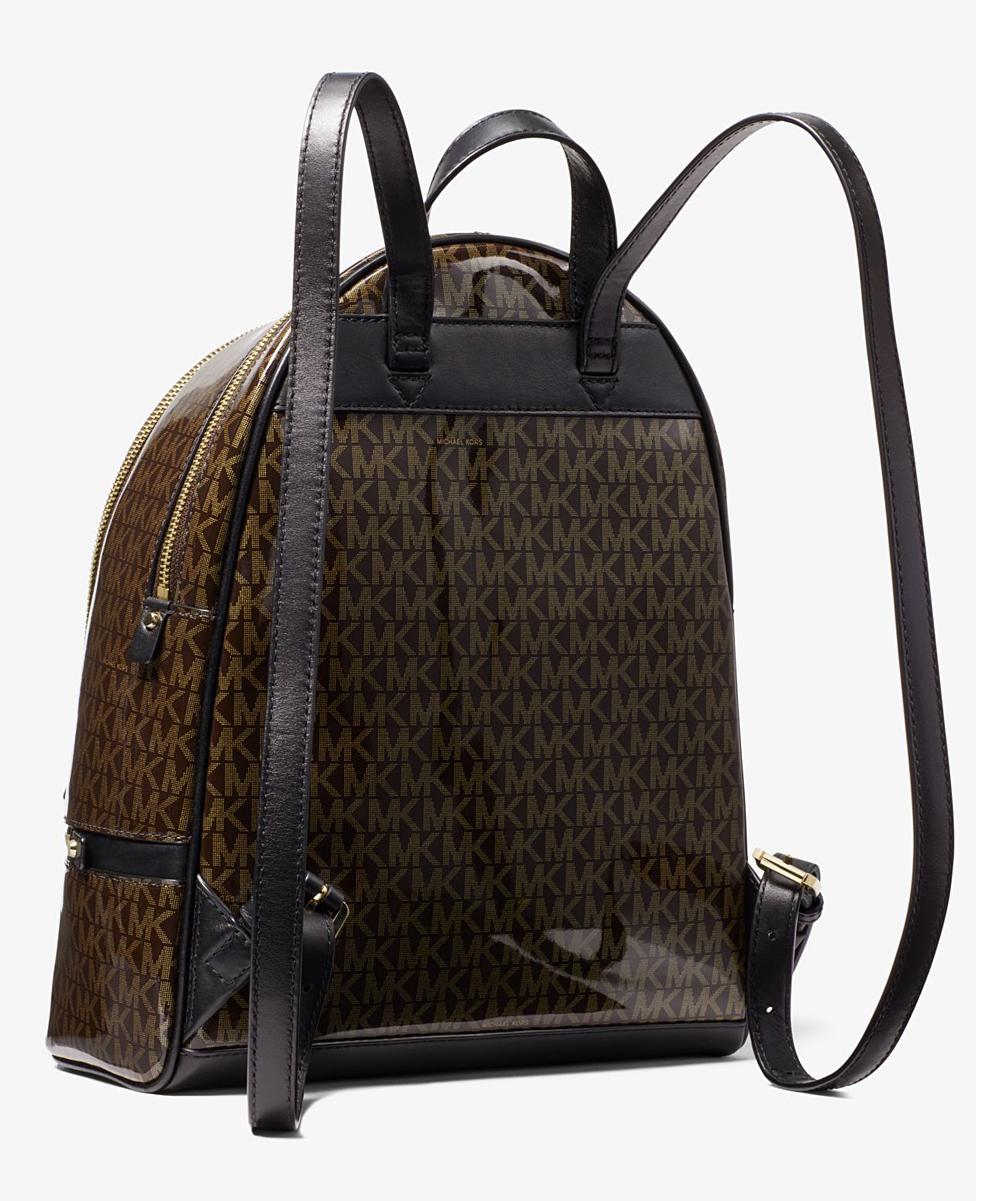a89f266964e7 Michael Kors Brown   Gold Signature Rhea Backpack