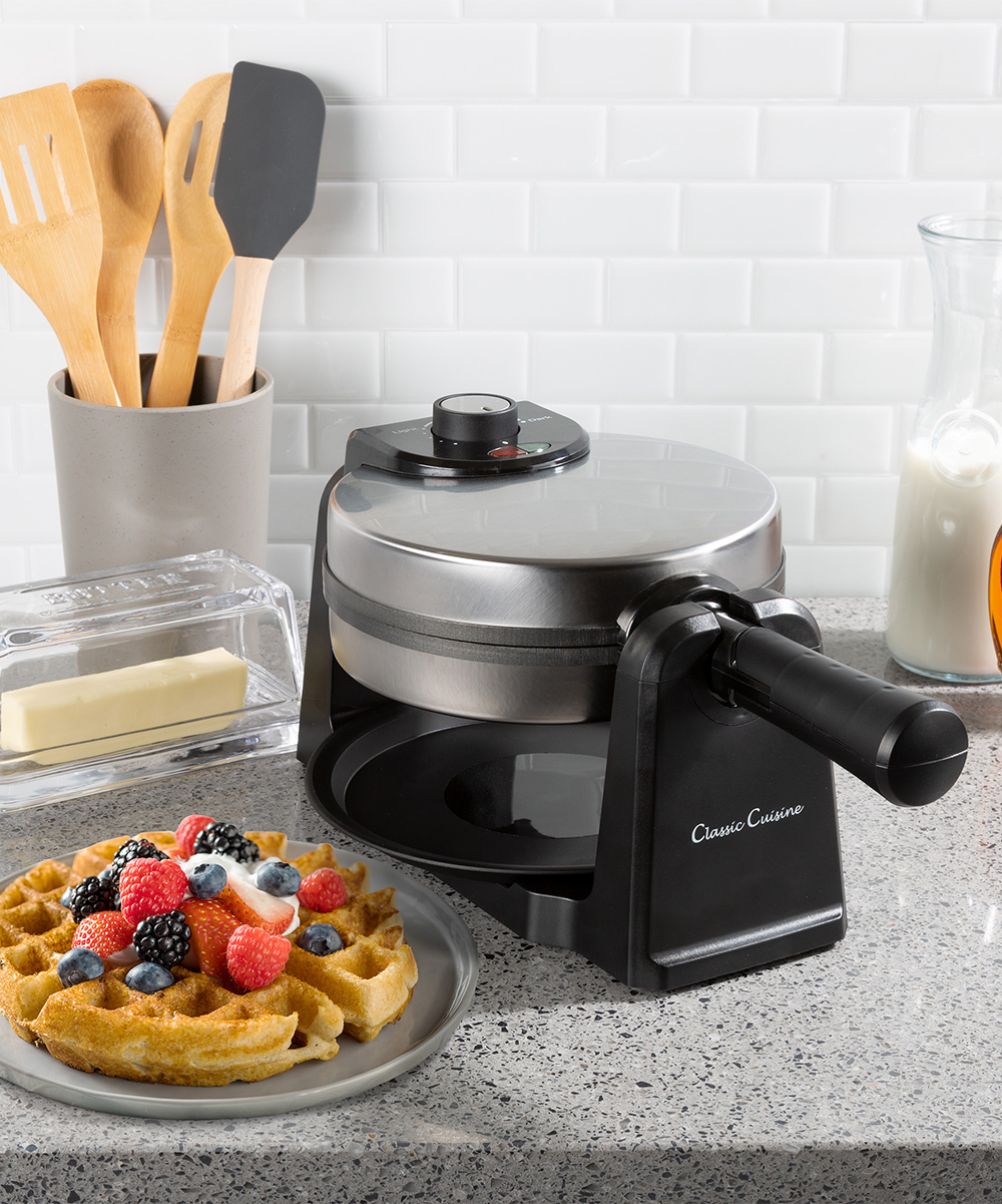 Classic Cuisine  Waffle Makers  - Classic 180-Degree Rotating Waffle Iron Classic 180-Degree Rotating Waffle Iron. Enjoy fresh, homemade waffles using this flip-style waffle maker that ensures an even cook every time with nonstick plates and a removable drip tray for easy cleanup. 15.5'' W x 8.5'' H x 7.5'' DWeight: 4.5lbMetal / plasticWipe cleanImported