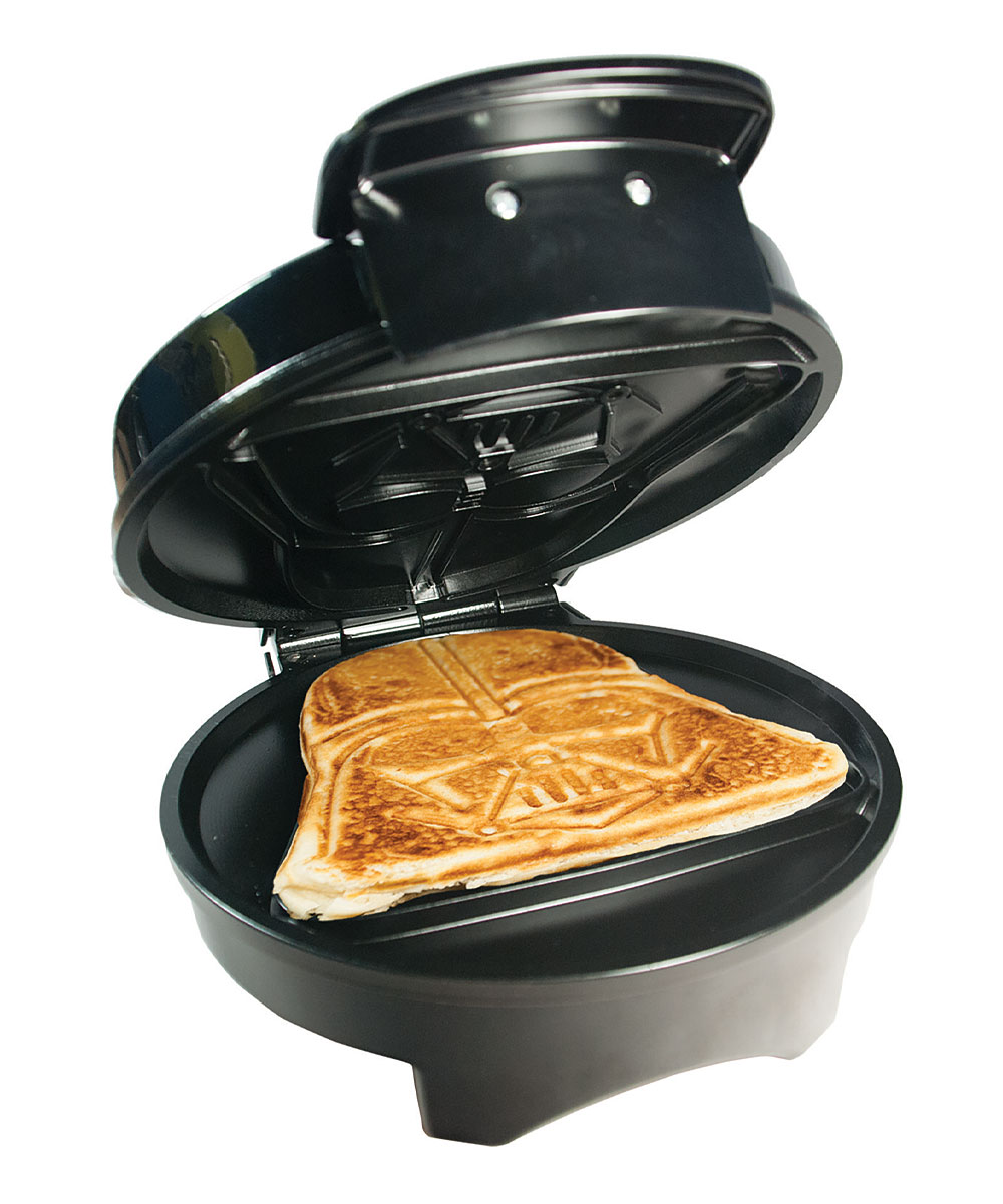 Uncanny Brands  Waffle Makers  - Star Wars Darth Vader Waffle Maker Star Wars Darth Vader Waffle Maker. Take a walk on the dark side of deliciousness with this waffle maker that features a Darth Vader design. 7.75'' W x 4.75'' H x 9.5'' DFive settingsIndicator lightsAbs / polypropyleneHand washImported