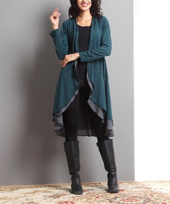 db8c4c77df0 ... now for Reborn Collection 1093 results. Black & Cream Houndstooth Notch  Neck Pin Tuck Tunic - Women. Emerald Open Drape Cardigan - Women