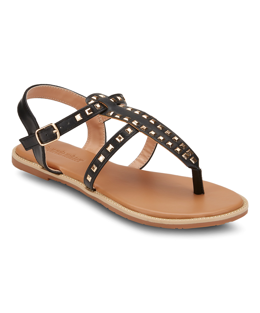 Black Stud-Accent Passion Fruit Sandals - Women Black Stud-Accent Passion Fruit Sandals - Women. Show off that pedicure in style by slipping into these strappy sandals elevated with stud accents for a touch of shine.Buckle closureMan-made upperMan-made liningMan-made soleImported