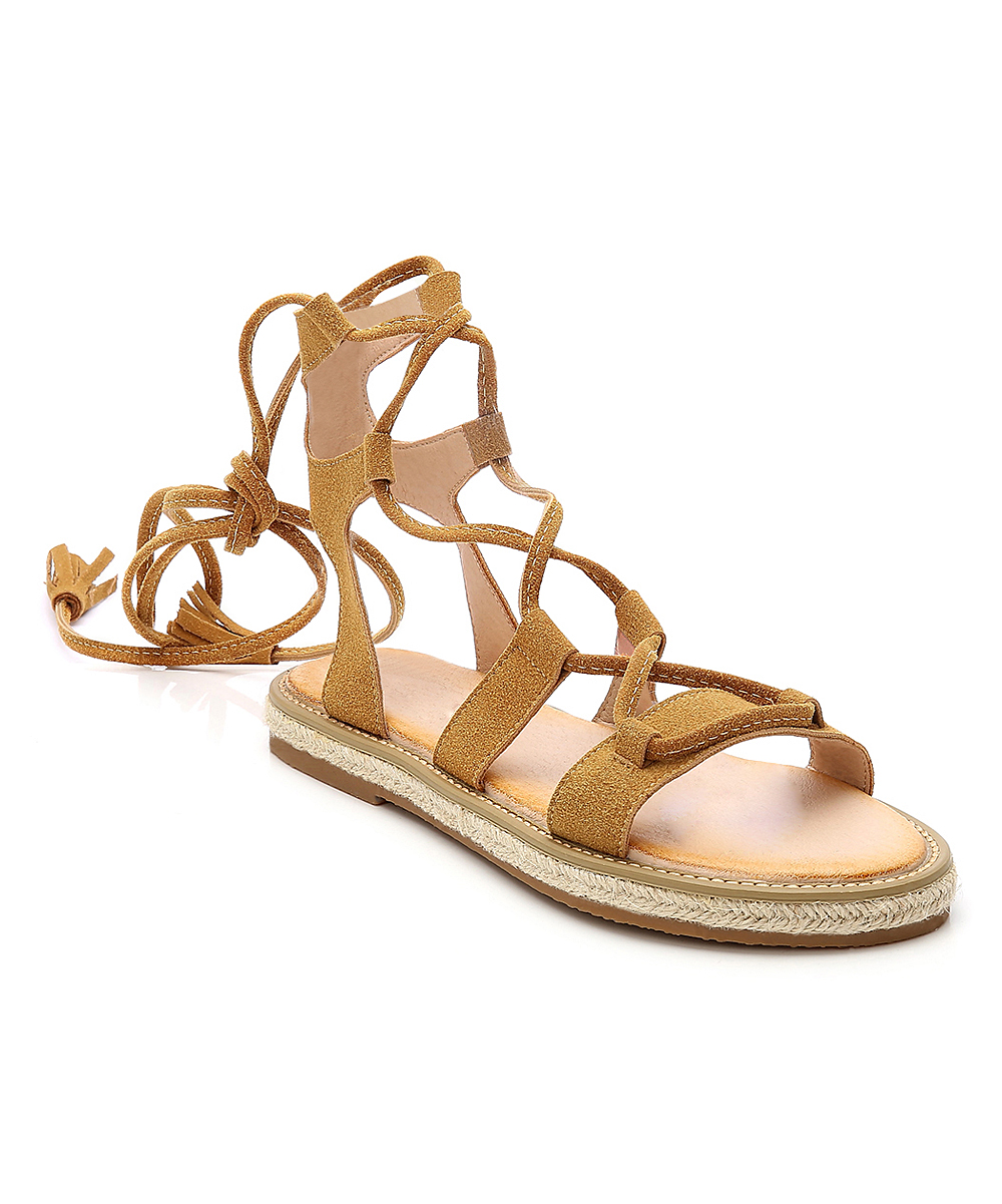 Tan Tassel Suede Platform Sandals - Women Tan Tassel Suede Platform Sandals - Women. Crafted with trendy tassels and soft suede, these lace-up gladiator sandals are a sunny-day shoe staple for comfortably stylish steps.Suede upperLeather liningMan-made soleImported