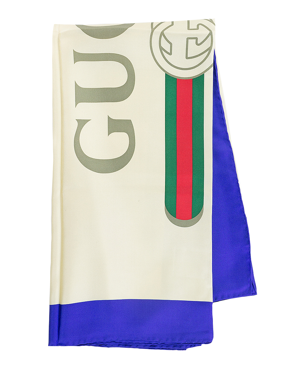 Blue & White 'Gucci' Silk Scarf Blue & White 'Gucci' Silk Scarf. Bring some silky smooth flair to your daily wardrobe with this classic scarf that effortlessly adds class to your ensemble. Full graphic text: Gucci.35.5'' W x 35.5'' HSilkImported