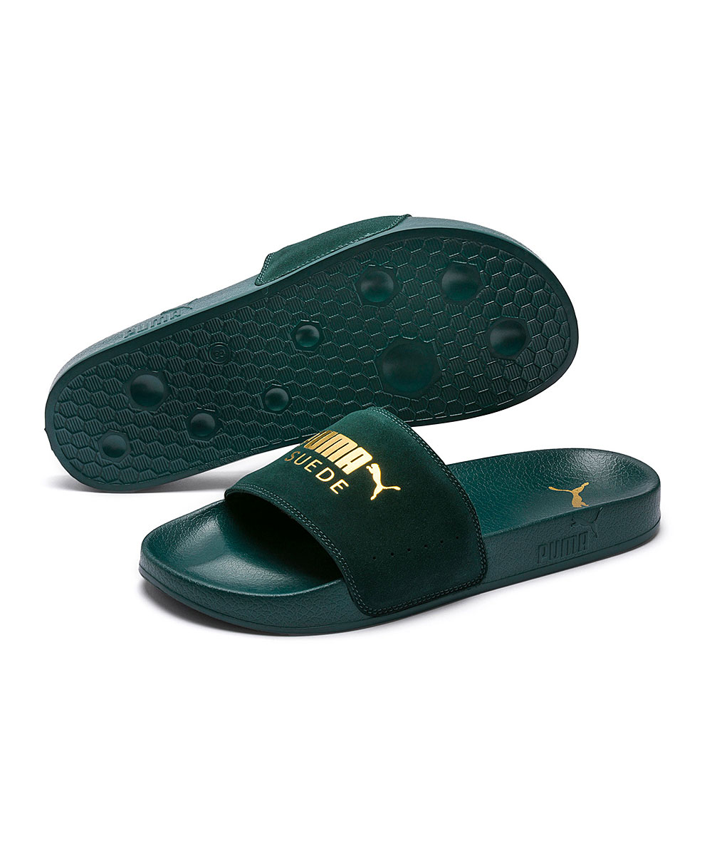 Ponderosa Pine & Puma Team Gold Leadcat Suede Slide - Men Ponderosa Pine & Puma Team Gold Leadcat Suede Slide - Men. He'll experience the most comfort possible in these lush suede slides featuring a premium, padded strap and molded footbed that moves with him.Molded footbedPadded strapSuede upperTextile liningEVA outsoleImported