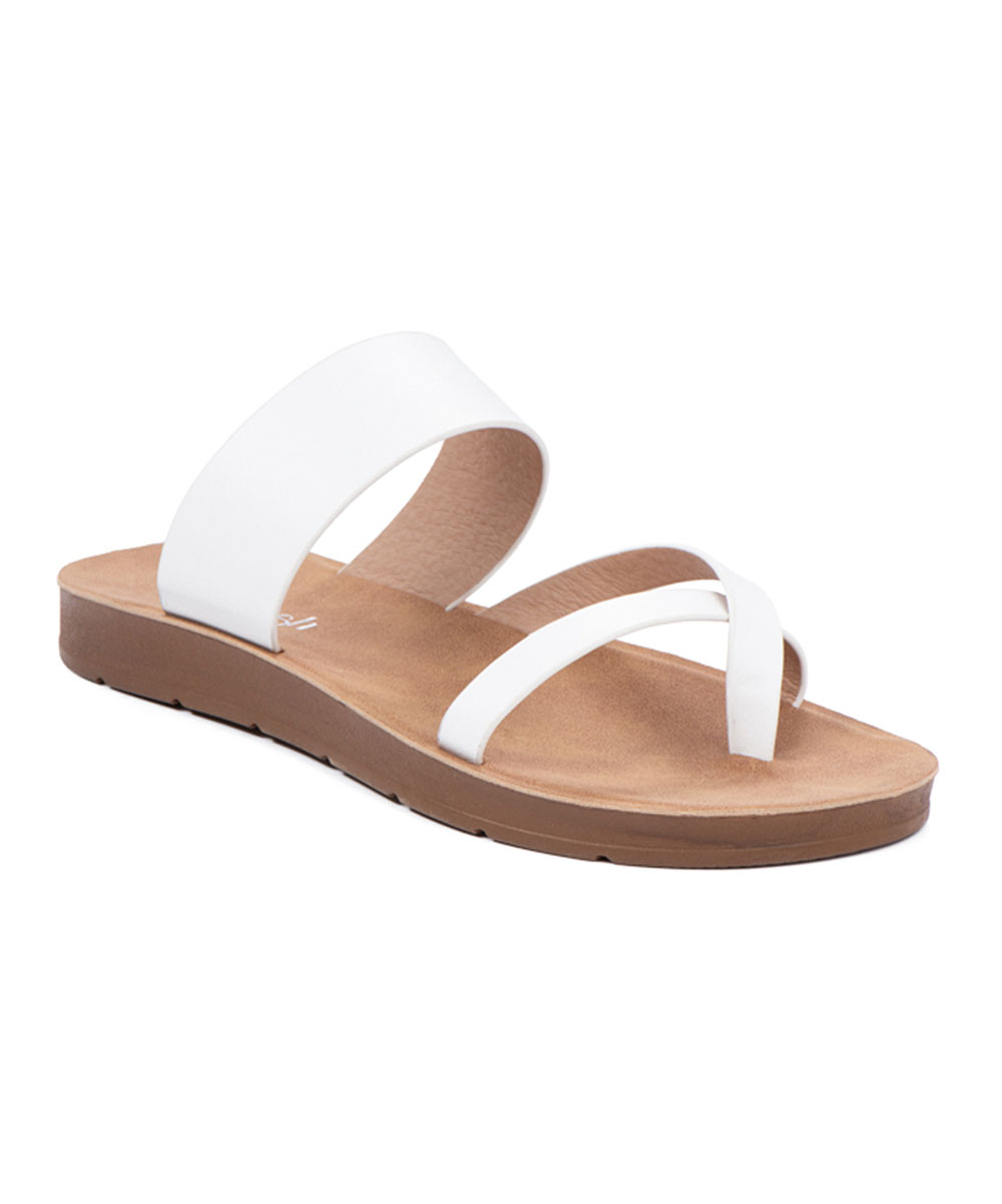 White Cross-Strap Ashley Sandals - Women White Cross-Strap Ashley Sandals - Women. Add some style to your sunny-day steps with these on-trend sandals flaunting contemporary crossed straps and subtle platforms for an extra lift. Man-made upperMan-made liningMan-made soleImported