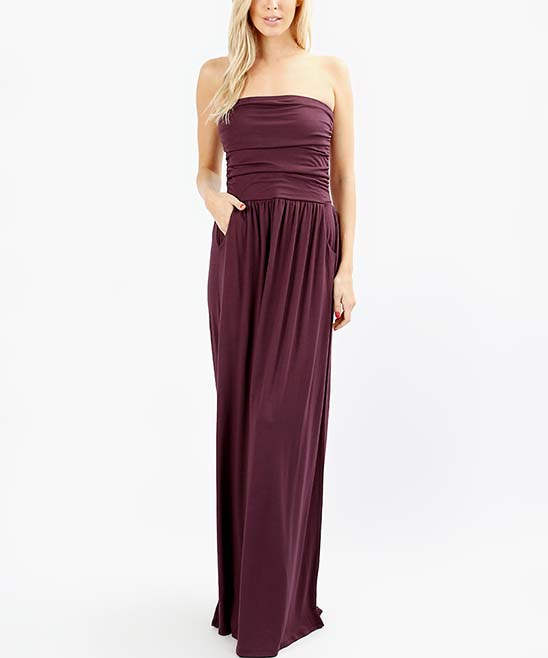Eggplant Pocket Strapless Maxi Dress - Women Eggplant Pocket Strapless Maxi Dress - Women. Easily dressed up with statement jewelry or dressed down with sandals, this elegant strapless maxi dress features convenient side pockets and an elastic waist for comfort. Size S: 50'' long from high point of shoulder to hemModel (wearing size S): 5'8'' tall; 34'' chest; 24'' waist; 36'' hips75% viscose / 22% polyester / 3% elastaneMachine wash Imported