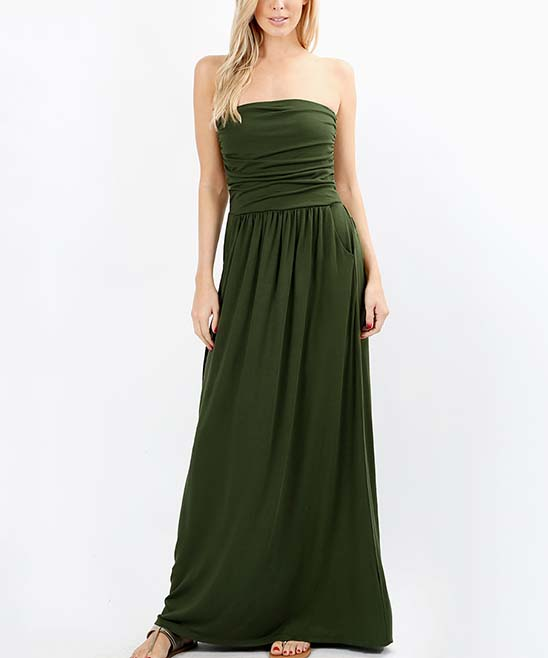 Army Green Pocket Strapless Maxi Dress - Women Army Green Pocket Strapless Maxi Dress - Women. Easily dressed up with statement jewelry or dressed down with sandals, this elegant strapless maxi dress features convenient side pockets and an elastic waist for comfort. Size S: 50'' long from high point of shoulder to hemModel (wearing size S): 5'8'' tall; 34'' chest; 24'' waist; 36'' hips75% viscose / 22% polyester / 3% elastaneMachine wash Imported