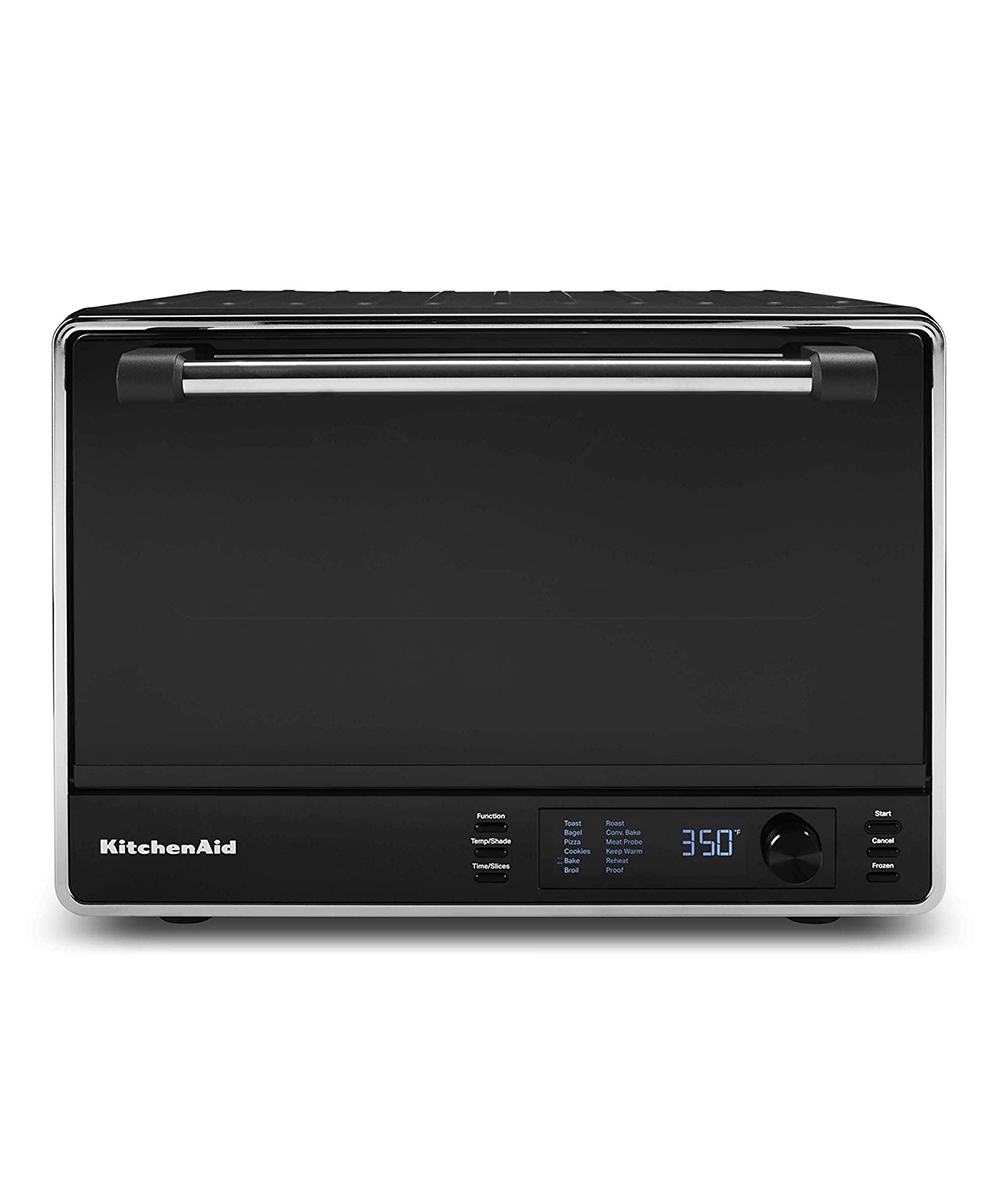 KitchenAid  Toaster Ovens Black - Black Matte Dual-Convection Countertop Oven Black Matte Dual-Convection Countertop Oven. Complete your culinary endeavors with this convenient, compact countertop oven that offers the heating power of a full-size oven with its dual-convection design. A built-in temperature probe offers precise control over the cooking process, and an interior light allows you to check the progress of your tasty meals. FeaturesBuilt-in temperature probe for more control during the cooking process12 preset cooking functionsDigital displayInterior light to check progress without disrupting your dishNonstick interior for quick cleaningProduct DetailsMetalModel number: KCO255BMImported