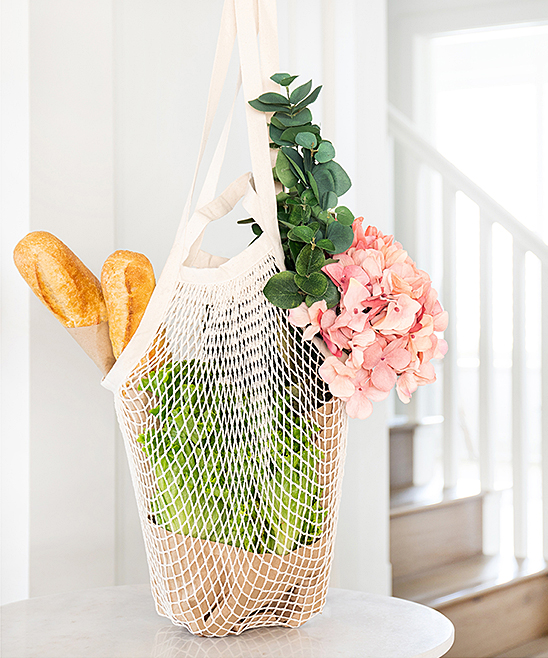 Cotton Net Dual Handle Shopping Bag Cotton Net Dual Handle Shopping Bag. Say goodbye to single-use plastic bags thanks to this handsome cotton shopping bag featuring a whimsical net construction. CottonImported