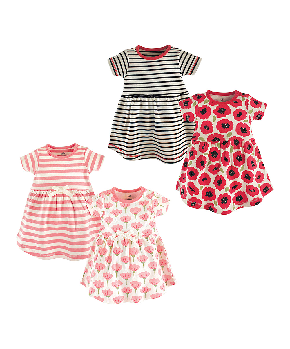 Floral Tulip Organic Cotton Dresses - Set of Four Floral Tulip Organic Cotton Dresses - Set of Four. Update your little lady's warm-weather wardrobe with these comfy dresses featuring adorable floral designs. Includes four dresses100% organic cottonMachine washImported