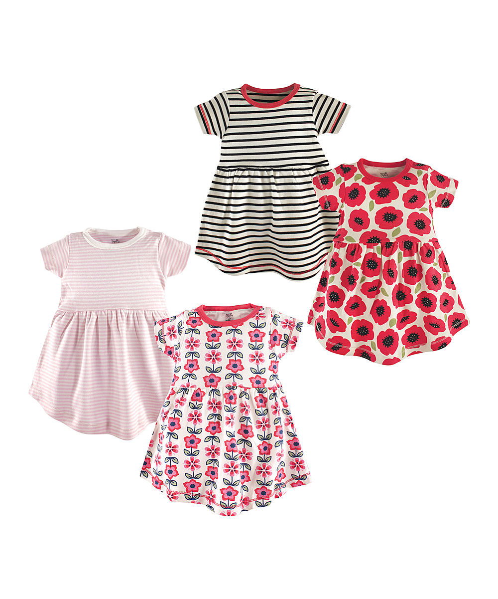 Floral Poppy Organic Cotton Dresses - Set of Four Floral Poppy Organic Cotton Dresses - Set of Four. Update your little lady's warm-weather wardrobe with these comfy dresses featuring adorable floral designs. Includes four dresses100% organic cottonMachine washImported