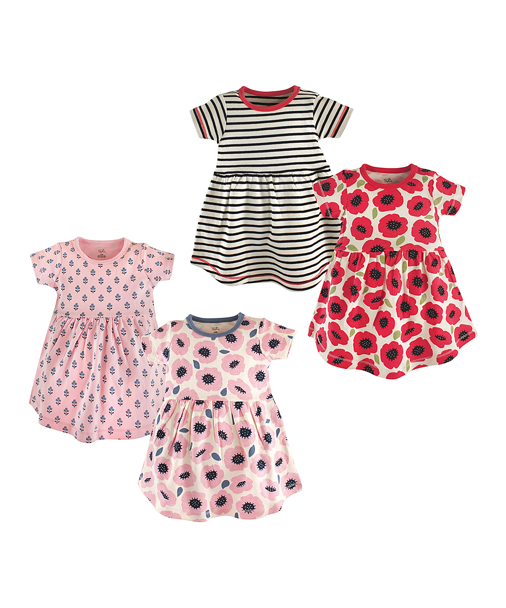 Floral Blossoms Organic Cotton Dresses - Set of Four Floral Blossoms Organic Cotton Dresses - Set of Four. Update your little lady's warm-weather wardrobe with these comfy dresses featuring adorable floral designs. Includes four dresses100% organic cottonMachine washImported
