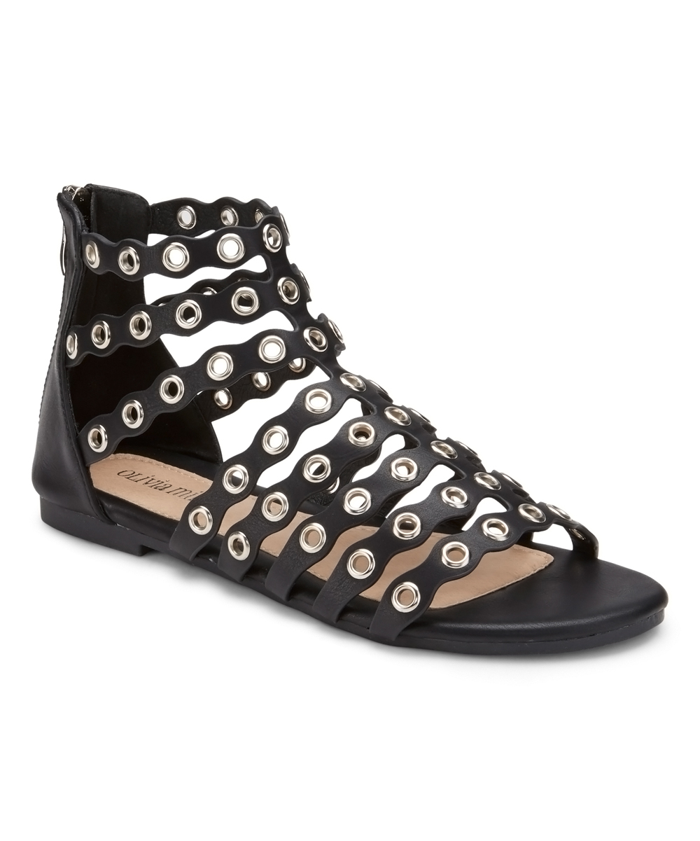 Black Grommet-Accent Popperazzi Sandals - Women Black Grommet-Accent Popperazzi Sandals - Women. Show off that pedicure in style by slipping into these strappy sandals elevated with grommet accents for an edgy touch of shine. Zip closureMan-made upperMan-made liningMan-made soleImported