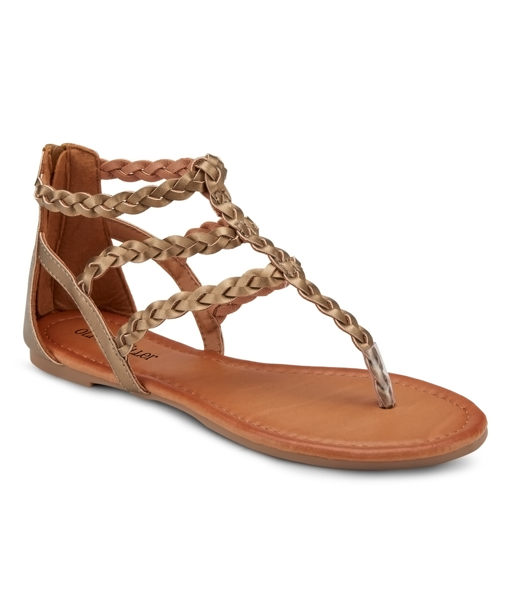 Bronze Braided Day Trippin Sandals - Women Bronze Braided Day Trippin Sandals - Women. Bring a bit of free-spirited style to favorite looks by slipping into these strappy sandals boasting braided detailing for boho style. Zip closureMan-made upperMan-made liningMan-made soleImported