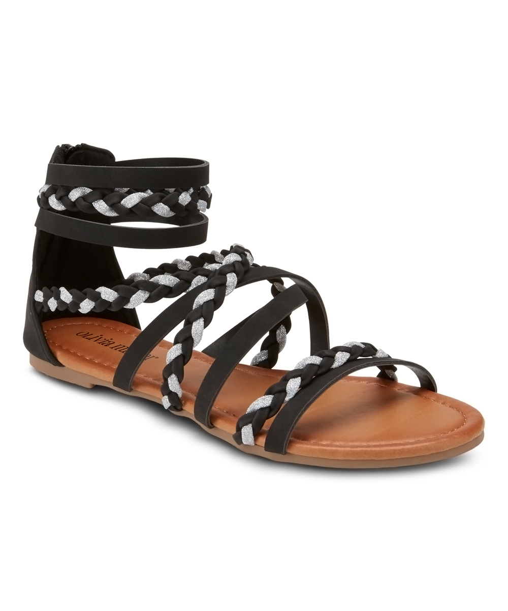 Black Braided High Tide Sandals - Women Black Braided High Tide Sandals - Women. Bring a bit of free-spirited style to favorite looks by slipping into these strappy sandals boasting braided detailing for boho style. Zip closureMan-made upperMan-made liningMan-made soleImported