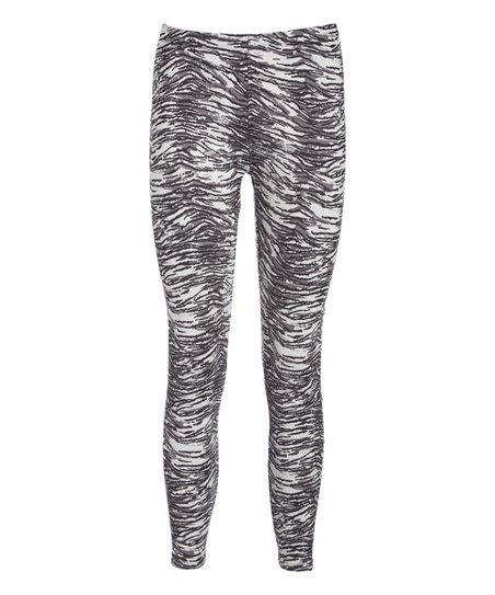 907bbfa52db7d0 love this product Black & White Zebra Fleece-Lined Leggings - Plus