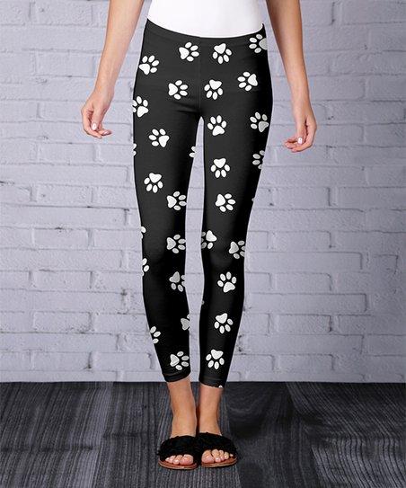 10e419f9dae976 love this product Black & White Paw Print Leggings - Women & Plus
