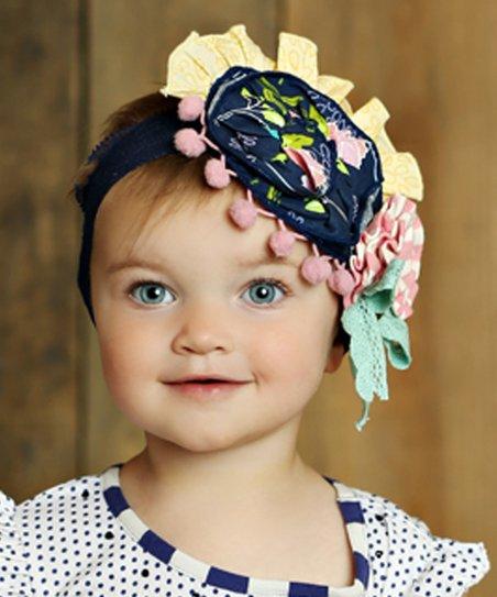 love this product Secret Garden Colette Pom-Pom Rosette Headband a79fe69d9da