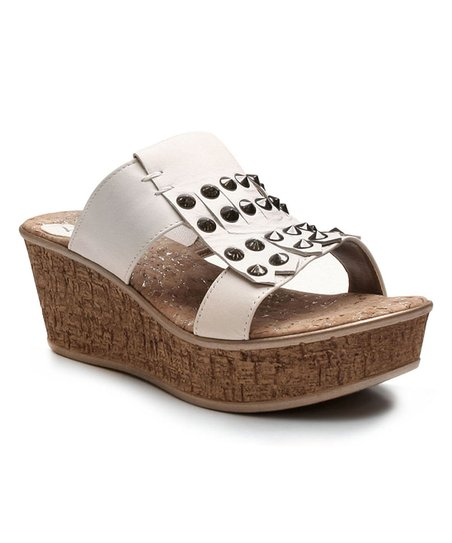 558f354cfbb9 love this product White Charlotte Studded Leather Wedge Sandal - Women