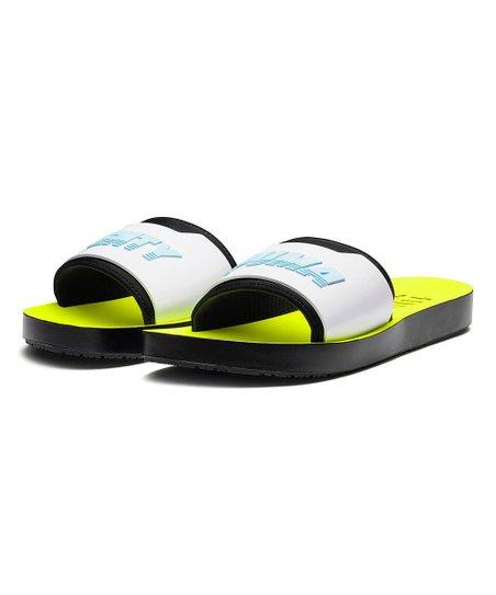 Fenty PUMA by Rihanna Safety Yellow   White Fenty Surf Slide - Women ... 8fd9bc238a77