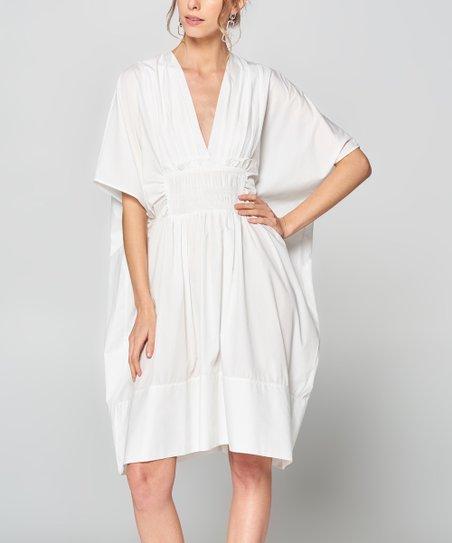aeb11e1401 love this product White Smocked V-Neck Dress - Women