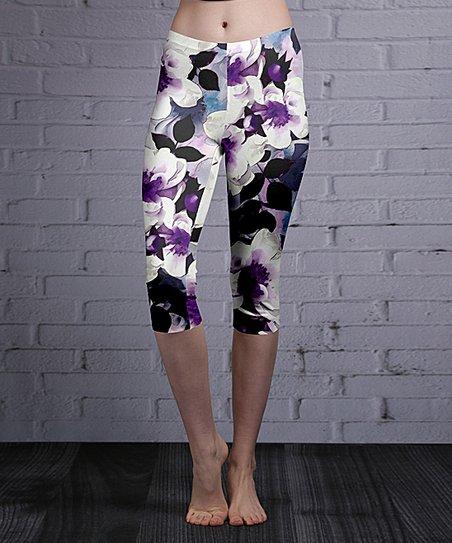 d291b9b110da42 love this product Purple & White Floral Capri Leggings - Women & Plus