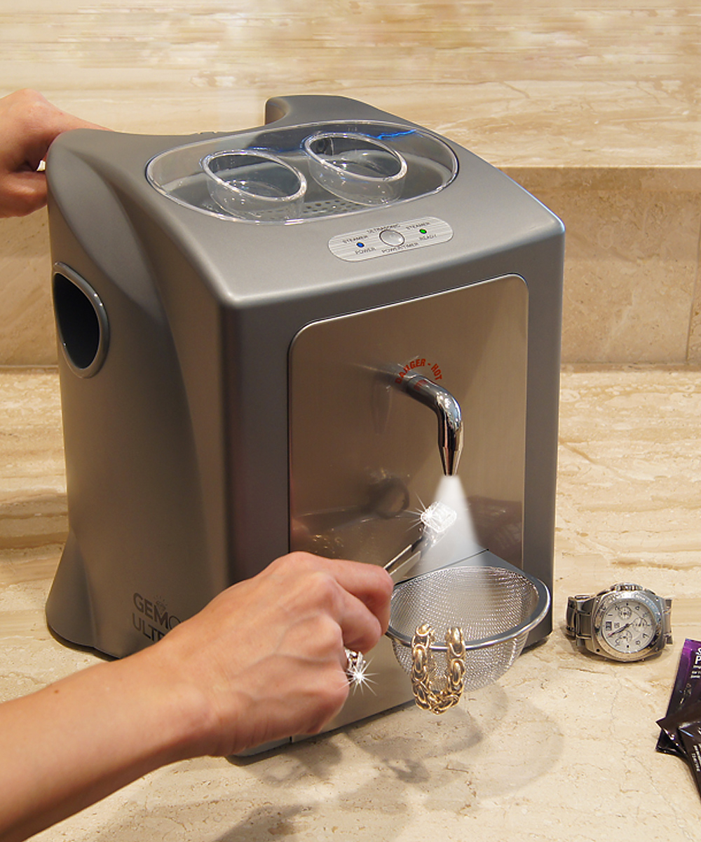 Silver UltraSpa Jewelry Cleaner Silver UltraSpa Jewelry Cleaner. Utilizing ultrasonic waves and high-pressure steam for professional results, this two-in-one cleaner restores shine and sparkle to diamonds, gold and more. Plus, its handle, storage drawer and small size are ideal for the home. Includes cleaner, steam residue mat, measuring fill cup, jewelry holding tweezers and two mesh baskets15.58'' W x 12.4'' H 13.75'' DPlastic / stainless steelOutput: 110 V US-standard plugImported